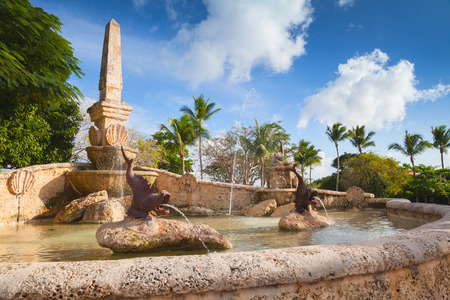 Fountain with fish sculptures. Altos de Chavon, old buildings facades, mediterranean style European village located atop the Chavon River in La Romana, Dominican Republic Stock Photo