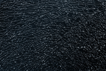 strained: Broken strained glass with cracks and fragments. Background photo texture