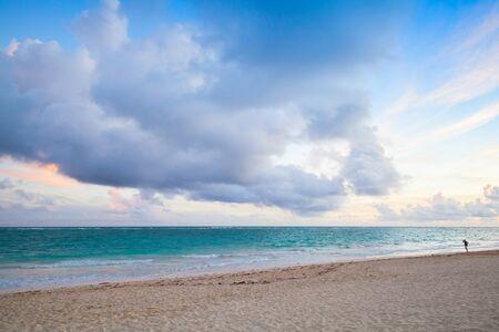 Atlantic ocean coast. Landscape with dramatic cloudy sky in sunrise, Dominican republic. Punta Cana. Bavaro beach