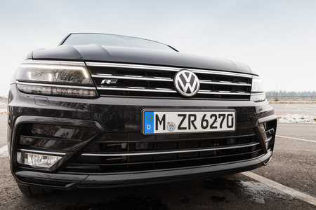 automaker: Hamburg, Germany - February 10, 2017: Outdoor photo of second generation Volkswagen Tiguan, 4x4 R-Line. Black compact crossover vehicle manufactured by German automaker Volkswagen, close-up Editorial