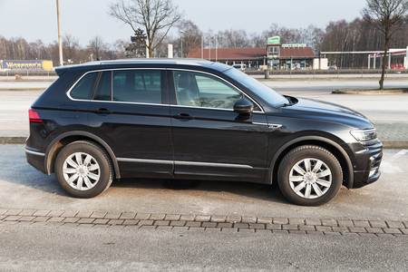 Hamburg, Germany - February 10, 2017: Outdoor photo of second generation Volkswagen Tiguan, 4x4 R-Line. Black compact crossover vehicle CUV manufactured by German automaker Volkswagen, side view