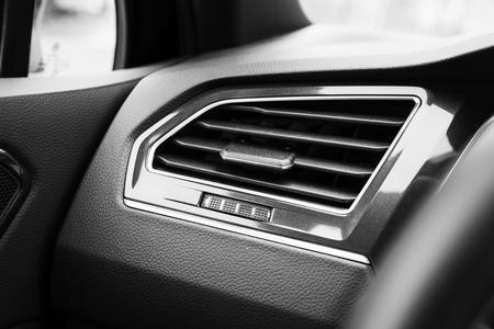 regulator: Air ventilation grille with power regulator, modern car interior detail Stock Photo