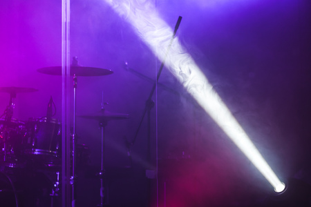 led lighting: Ray of scenic spot light over blurred csenic background, stage illumination equipment Stock Photo
