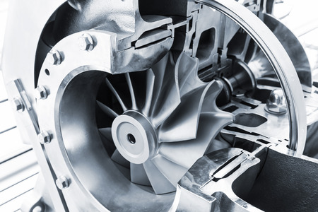 Turbocharger structure illustration with cross section, blue toned photo with soft selective focus