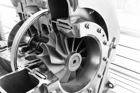 Turbocharger structure scheme with cross section, black and white photo with selective focus