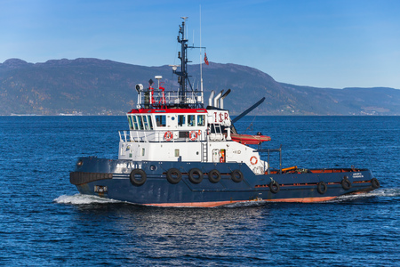 abramis: Trondheim, Norway - October 17, 2016: Abramis Tug boat with white superstructure underway, side view. Trondheim, Norway