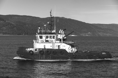 abramis: Trondheim, Norway - October 17, 2016: Abramis tug boat with white superstructure underway, side view. Trondheim, Norway. Monochrome photo
