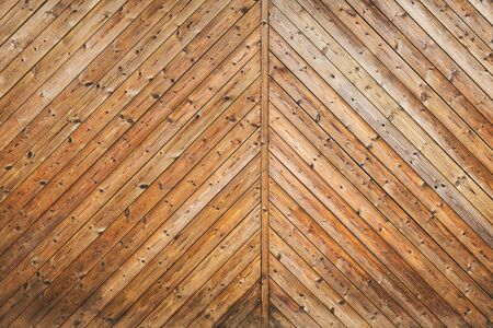 Uncolored wooden gate fragment, flat background photo texture