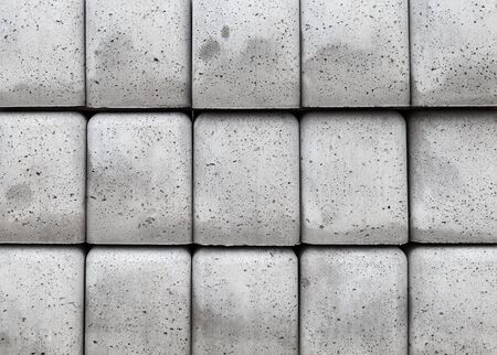 beton: Stack of gray concrete blocks, abstract industrial background photo texture