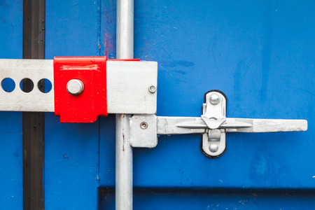 standard steel: Gate valve and lock of standard blue cargo shipping container
