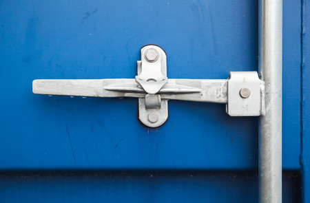 standard steel: Gate valve of standard blue cargo shipping container Stock Photo