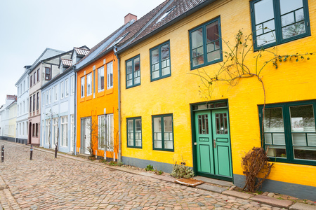 Traditional colorful living houses along the street in old town of Flensburg city, Germany