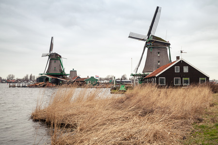 zaan: Windmills on the Zaan river coast, Zaanse Schans town is one of the popular tourist attractions of the Netherlands Stock Photo