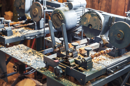 klompen: Woodworking machines in manufacturing facility of Klompen, traditional Dutch shoes for everyday use