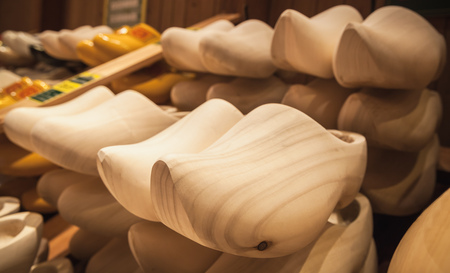 klompen: Uncolored clogs made of poplar wood. Klompen, traditional Dutch shoes for everyday use stand in a row
