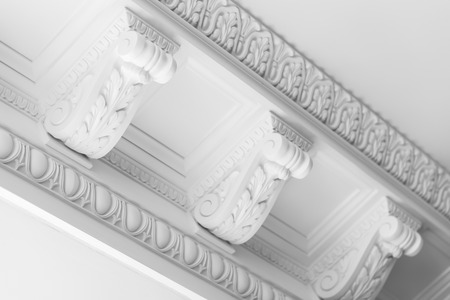 Round decorative clay stucco relief moldings with floral ornaments on white ceiling in abstract classical style interior