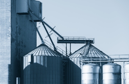 Industrial building with steel tanks, blue toned exterior photo Stock Photo