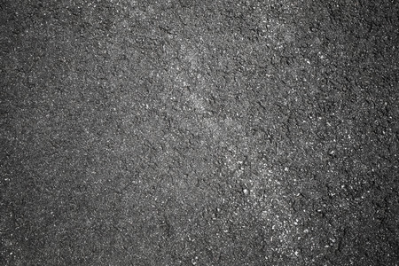 Dark gray tarmac with old highway road marking. Abstract transportation background texture