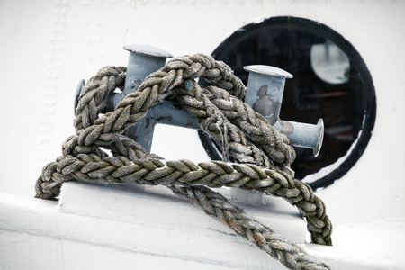 docked: Mooring bollard with rope mounted on old ship deck