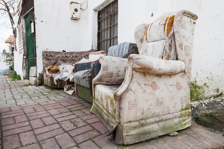 trashed: Old abandoned furniture on narrow street of Izmir, Turkey