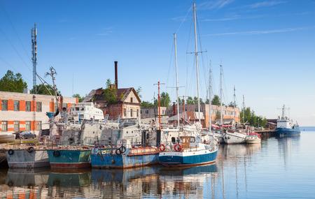 Sailing ships moored in Lomonosovskaya gavan of Baltic Sea. Saint-Petersburg region, Russia Stock Photo