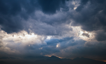 Dramatic tropical sky with dark clouds at late evening, abstract nature background