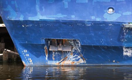Bow anchor of old blue cargo ship