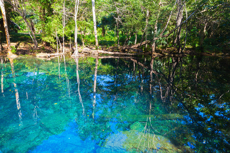 Still blue lake in forest, landscape of Dominican Republic