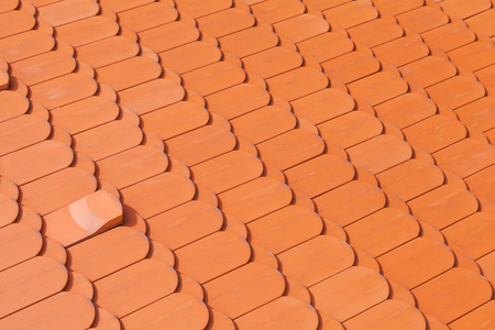 tiling: New red roof tiling, close-up background photo texture