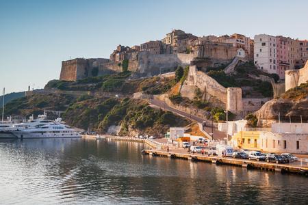 Bonifacio port in warm morning sunlight, mountainous Mediterranean island Corsica, Corse-du-Sud, France Editorial