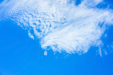Blue sky with layer of white clouds, natural background photo texture
