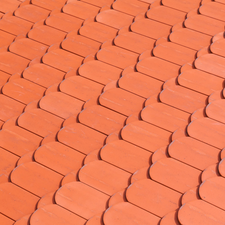 tiling: New red roof tiling, close-up square background photo texture