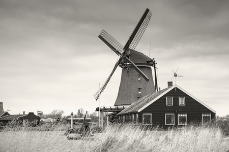 zaandam: Windmill in Zaanse Schans town. It is one of the popular tourist attractions of the Netherlands. Retro stylized sepia toned monochrome photo