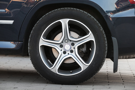 Imatra, Finland - May 8, 2016: Close-up photo of car wheel designed by AMG with Mercedes Benz logotype