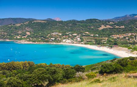 Summer coastal landscape of Corsica. Small azure bay with beach. Piana region, France