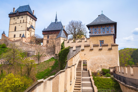 iv: Karlstejn castle exterior. Gothic castle founded 1348 CE by Charles IV, Holy Roman Emperor-elect and King of Bohemia. Located in Karlstejn village, Czech Republic