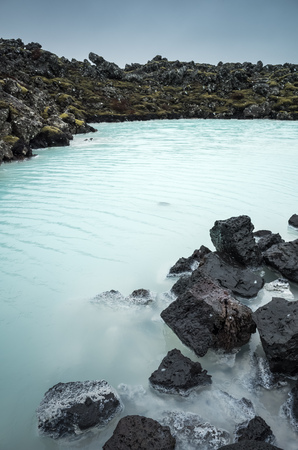 Iceland, Blue lagoon coastal landscape with rocks. This geothermal spa is one of the most visited attractions in Iceland Stock Photo