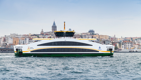 Istanbul, Turkey - June 28, 2016: Passenger ferry goes on Golden Horn, a major urban waterway and primary inlet of Bosphorus in Istanbul Editorial