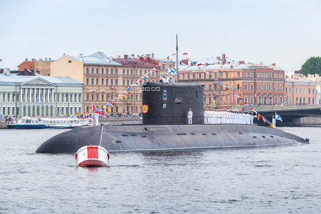 battleship: Saint-Petersburg, Russia - July 28, 2017: Submarine stand on Neva. Rehearsal for the parade of Russian naval forces. Kilo class is the NATO reporting name for a naval diesel-electric attack submarine Editorial