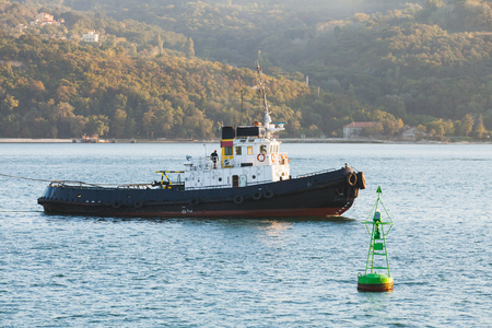 Tug boat is underway on Black sea, Bulgaria