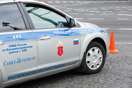 leningrad: Saint-Petersburg, Russia - July 28, 2017: Russian traffic police car with Saint-Petersburg city coat of arm on door Editorial