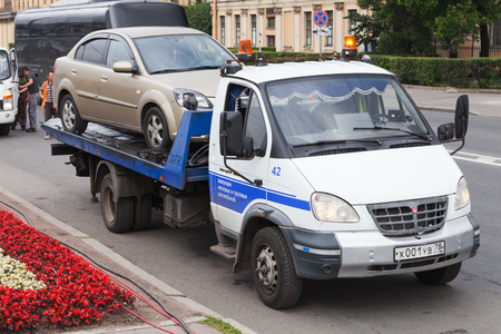 Saint-Petersburg, Russia - July 28, 2017: Car evacuation, city car is on small service truck