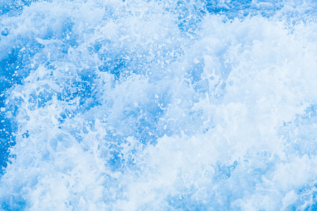 Blue sea water with splashes and foam, natural background photo texture
