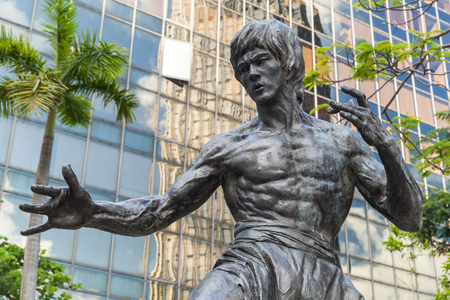 Hong Kong - July 13, 2017: Closeup photo of Bruce Lee statue located in Hong Kong Garden of Stars. Tsim Sha Tsui East Waterfront Podium Garden