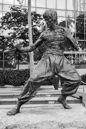 Hong Kong - July 13, 2017: Black and white photo of Bruce Lee statue located in Hong Kong Garden of Stars. Tsim Sha Tsui East Waterfront Podium Garden.