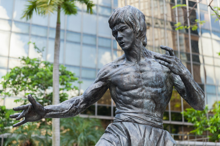 Hong Kong - July 13, 2017: Close-up photo of Bruce Lee statue located in Hong Kong Garden of Stars. Tsim Sha Tsui East Waterfront Podium Garden. Editorial