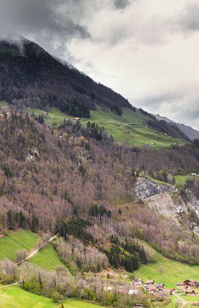 Rural Swiss landscape. Lungern village under dark cloudy sky