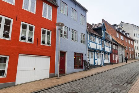Street view with traditional colorful living houses. Flensburg city, Germany