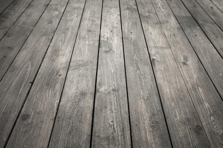 Dark gray wooden floor, background photo texture with perspective effect