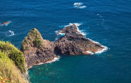 Seaside landscape of Portugal. Coastal rocks of Madeira island, Bridal Veil Falls viewpoint 写真素材